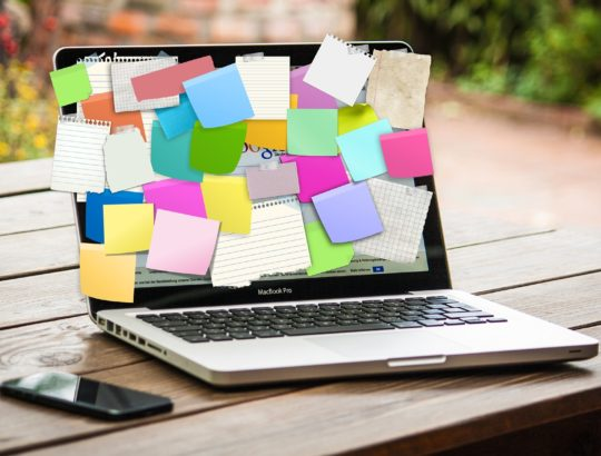 laptop with all the sticky notes- balance your life