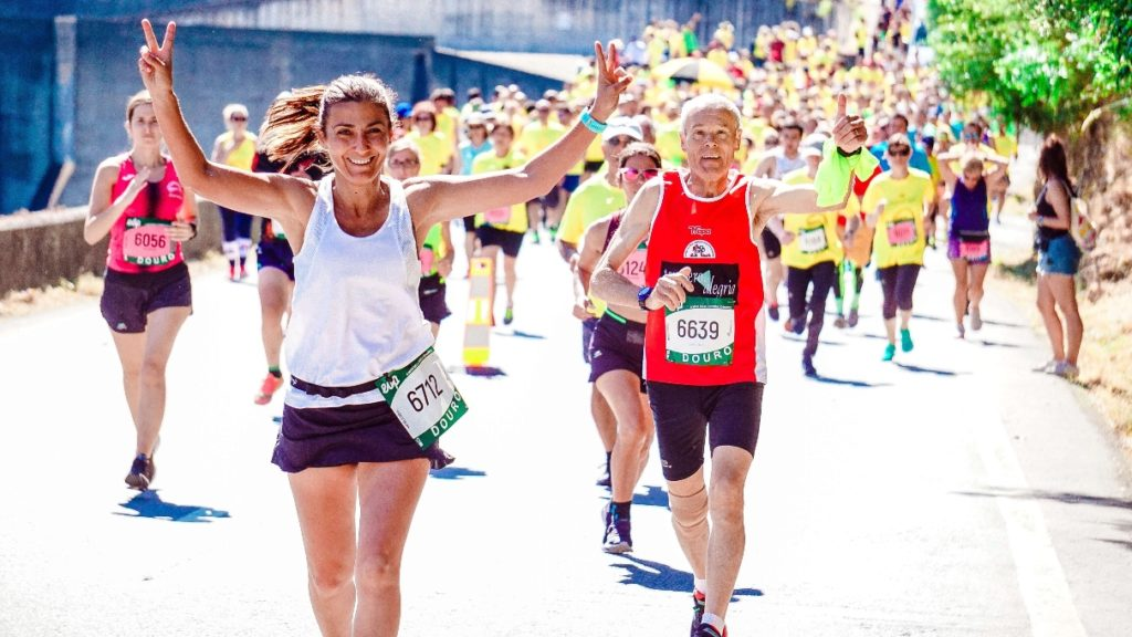 people of all ages running in a marathon